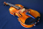 FILE - In this Wednesday, March 8, 2017 file photo, the Ames Stradivarius violin is seen in New York. The Stradivarius violin stolen four decades ago from the late virtuoso Roman Totenberg and returned to his family by a federal prosecutor came alive again _ at the crime scene, playing the same music.  At a concert in Cambridge, Massachusetts, 19-year-old star violinist Nathan Meltzer revived the priceless instrument of the Polish-born musician on Friday evening, Nov. 15, 2019.  (AP Photo/Seth Wenig, File)