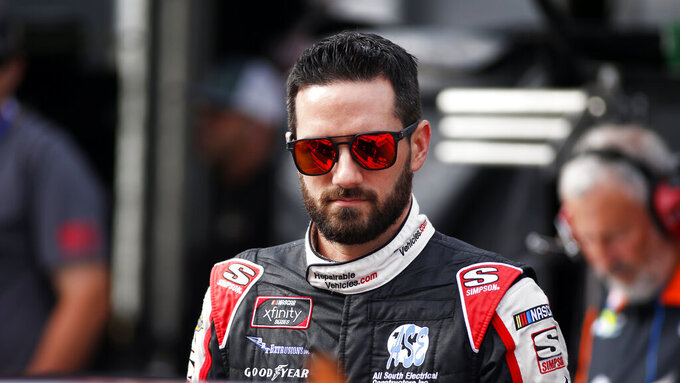 Driver Jeremy Clements is seen in the pits before practice for an NASCAR Xfinity Series auto race on Thursday, Aug. 15, 2019, in Bristol, Tenn. (AP Photo/Wade Payne)