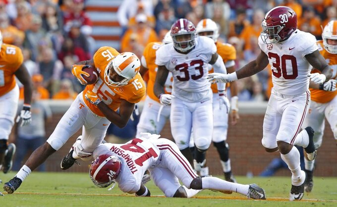 Tennessee wide receiver Jauan Jennings (15) is hit by Alabama defensive back Deionte Thompson (14) in the first half of an NCAA college football game Saturday, Oct. 20, 2018, in Knoxville, Tenn. (AP Photo/Wade Payne)