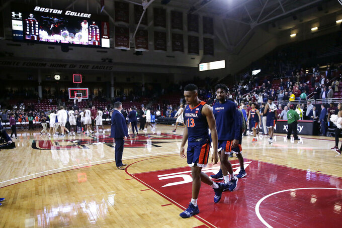 Virginia guard Casey Morsell (13) walks to the locker room after a loss to Boston College during an NCAA college basketball game Tuesday, Jan. 7, 2020 in Boston. Boston College upset Virginia 60-53. (AP Photo/Charles Krupa)