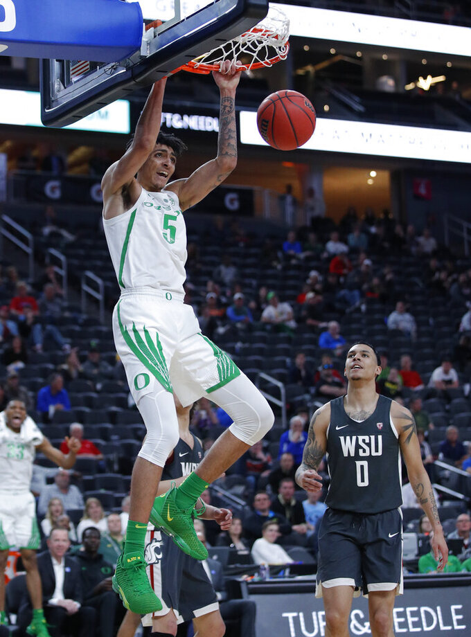 Oregon's Miles Norris dunks against Washington State during the second half of an NCAA college basketball game in the first round of the Pac-12 men's tournament Wednesday, March 13, 2019, in Las Vegas. (AP Photo/John Locher)