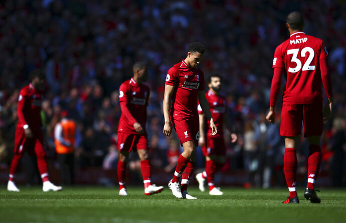 Liverpool players come out for the second half during the English Premier League soccer match between Liverpool and Wolverhampton Wanderers at the Anfield stadium in Liverpool, England, Sunday, May 12, 2019. Despite a 2-0 win over Wolverhampton Wanderers, Liverpool missed out on becoming English champion for the first time since 1990 because title rival Manchester City beat Brighton 4-1. (AP Photo/Dave Thompson)