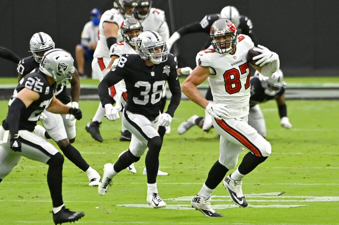 Tampa Bay Buccaneers tight end Rob Gronkowski (87) runs against Las Vegas Raiders strong safety Jeff Heath (38) during the first half of an NFL football game, Sunday, Oct. 25, 2020, in Las Vegas. (AP Photo/David Becker)