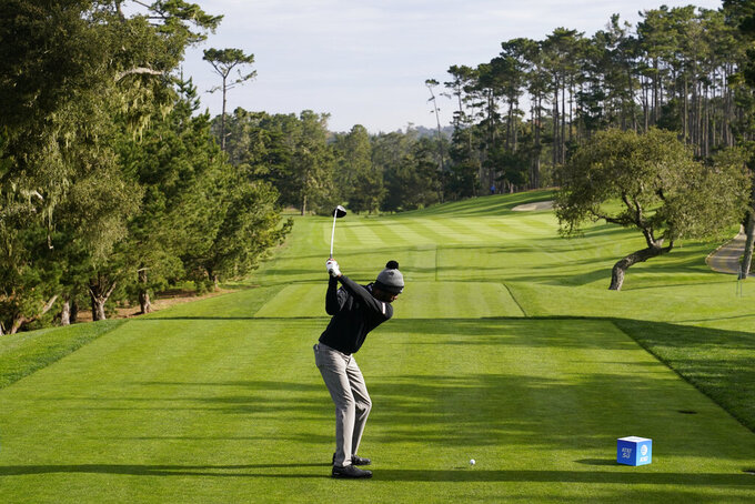Kamaiu Johnson hits from the 10th tee of the Spyglass Hill Golf Course during the first round of the AT&T Pebble Beach Pro-Am golf tournament, Thursday, Feb. 11, 2021, in Pebble Beach, Calif. (AP Photo/Eric Risberg)