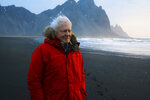 This image released by BBC America shows David Attenborough in Iceland. Attenborough narrates a new seven-part documentary series premiering Saturday on BBC America, AMC, IFC and SundanceTV.  (Alex Board/BBCAmerica via AP)