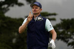 Justin Rose, of England, watches his tee shot on the 14th hole during the third round of the PGA Championship golf tournament at TPC Harding Park Saturday, Aug. 8, 2020, in San Francisco. (AP Photo/Jeff Chiu)