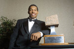 FILE - In this Dec. 5, 2001, file photo, North Carolina defensive end Julius Peppers poses with the 2001 Lombardi Award before an awards ceremony in Houston. Josh Heupel, who was the Heisman Trophy runner-up for Oklahoma in 2000, and former North Carolina pass-rushing star Julius Peppers are among 12 players making their first appearance of the College Football Hall of Fame ballot this year. (AP Photo/Michael Stravato, File)