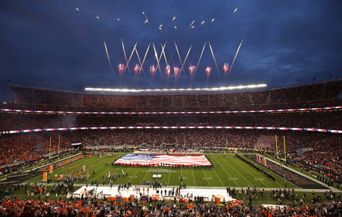 Andy Grammers sings the national anthem before the NCAA college football playoff championship game between Alabama and Clemson, Monday, Jan. 7, 2019, in Santa Clara, Calif. (AP Photo/Jeff Chiu)