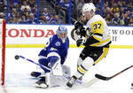 Pittsburgh Penguins center Sam Lafferty (37) shoots wide of Tampa Bay Lightning goaltender Andrei Vasilevskiy (88) during the first period of an NHL hockey game Wednesday, Oct. 23, 2019, in Tampa, Fla. (AP Photo/Chris O'Meara)