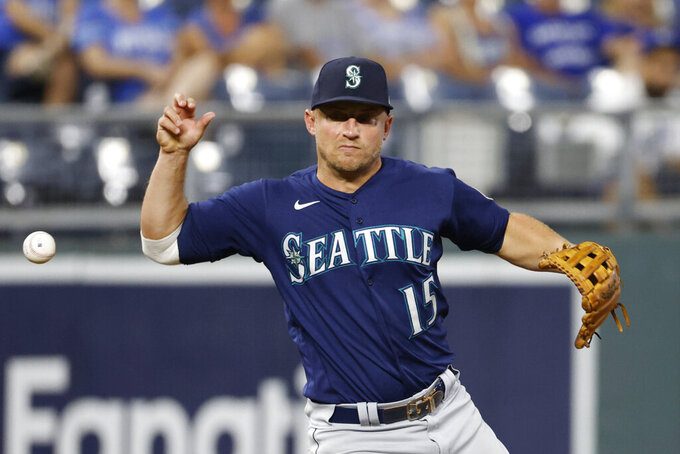 Seattle Mariners third baseman Kyle Seager loses the ball after fielding a grounder from Kansas City Royals' Whit Merrifield during the eighth inning of a baseball game at Kauffman Stadium in Kansas City, Mo., Saturday, Sept. 18, 2021. Seager was charged with an error on the play. (AP Photo/Colin E. Braley)