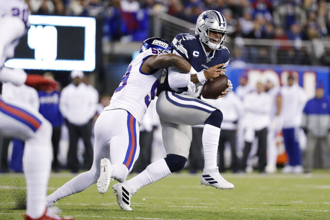 Dallas Cowboys quarterback Dak Prescott (4) is sacked by New York Giants linebacker Lorenzo Carter (59) during the first quarter of an NFL football game, Monday, Nov. 4, 2019, in East Rutherford, N.J. (AP Photo/Adam Hunger)