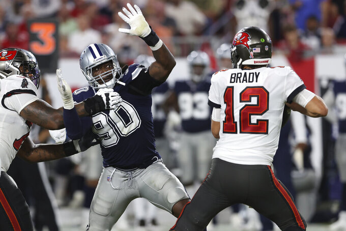 Dallas Cowboys defensive end DeMarcus Lawrence (90) pressures Tampa Bay Buccaneers quarterback Tom Brady (12) during the second half of an NFL football game Thursday, Sept. 9, 2021, in Tampa, Fla. (AP Photo/Mark LoMoglio)