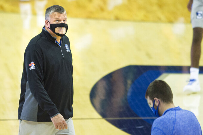 Creighton head coach Greg McDermott looks up at the scoreboard during a timeout in the second half of an NCAA college basketball game against North Dakota State in Omaha, Neb., Sunday, Nov. 29, 2020. (AP Photo/Kayla Wolf)