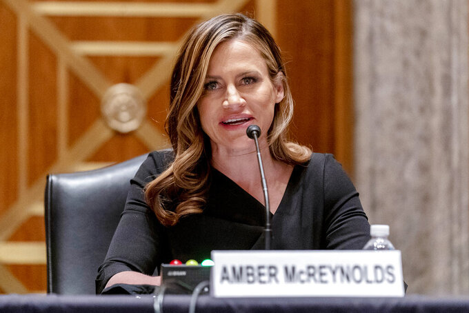 Amber McReynolds, one of the nominees for Postal Service Governors, speaks at a Senate Governmental Affairs Committee hybrid nominations hearing on Capitol Hill, Thursday, April 22, 2021, in Washington. (AP Photo/Andrew Harnik)
