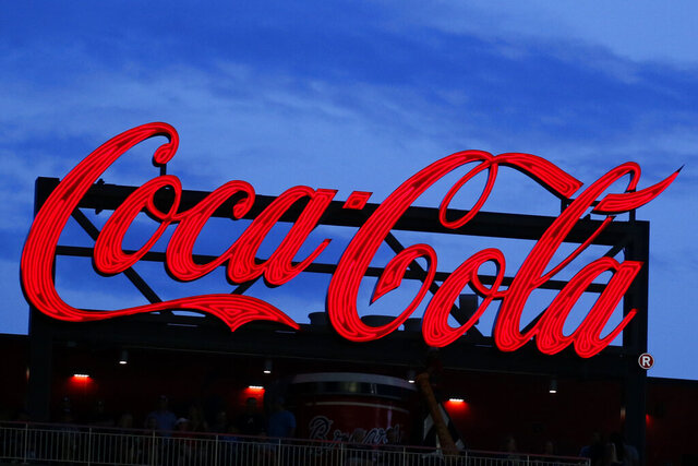 FILE - In this July 20, 2019, photo a Coca-Cola billboard is shown over left field at SunTrust Park during a baseball game between the Washington Nationals and Atlanta Braves in Atlanta. With the help of Molson Coors, Coca-Cola will start selling hard seltzer. The companies said the new alcoholic beverage will come in the form of Topo Chico Hard Seltzer, which they hope to have on store shelves in the first half of 2021.  (AP Photo/John Bazemore, File)