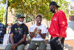 NBA star and current Winston-Salem State University student Chris Paul talks basketball with Winston-Salem State University students, from left, Donovan Tillman and Zayquan Osborne on Tuesday, Oct. 27, 2020, in Winston-Salem, N.C.  Paul led nearly 2,500 people on a march to an early-voting site at the university in North Carolina where he also takes classes. (Andrew Dye/The Winston-Salem Journal via AP)