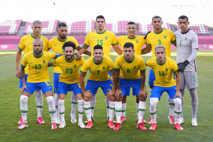 Brazil's players pose for a team photo prior to a men's soccer semifinal match against Mexico at the 2020 Summer Olympics, Tuesday, Aug. 3, 2021, in Kashima, Japan. (AP Photo/Andre Penner)