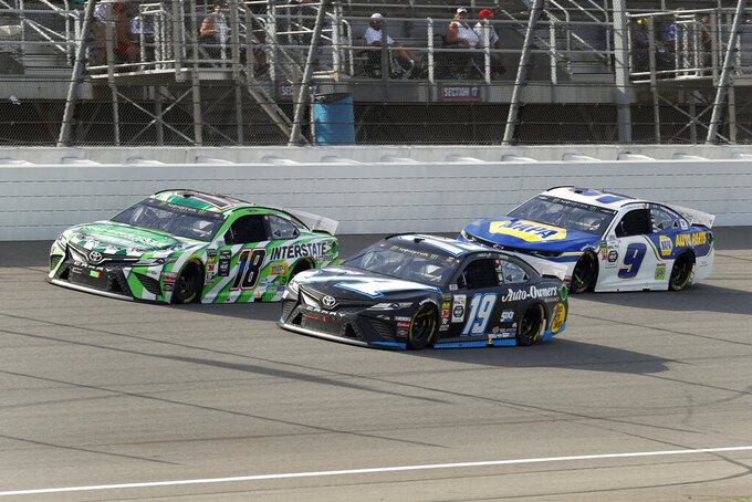 Kyle Busch (18), Martin Truex Jr. (19) and Chase Elliott (9) race during a NASCAR Cup Series auto race at Michigan International Speedway in Brooklyn, Mich., Sunday, Aug. 11, 2019. (AP Photo/Paul Sancya)
