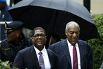 In this Sept. 25, 2018, file photo, Bill Cosby, right, and spokesman Andrew Wyatt arrive for Cosby's sentencing hearing at the Montgomery County Courthouse in Norristown Pa. The Pennsylvania judge who presided over Cosby's sex-assault case says he let five other accusers testify at Cosby's retrial because they showed his actions were