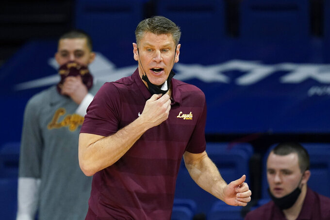 Loyola of Chicago head coach Porter Moser directs his team during the first half of an NCAA college basketball game against Drake, Saturday, Feb. 13, 2021, in Des Moines, Iowa. (AP Photo/Charlie Neibergall)