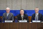 Secretary of State Mike Pompeo, center, flanked by James Jeffrey, the State Department's Special Representative on Syria, left, and NATO Secretary General Jens Stoltenberg, right, speaks at the State Department in Washington, Thursday, Nov. 14, 2019, for the Global Coalition to Defeat ISIS Small Group Ministerial meeting. (AP Photo/Susan Walsh)