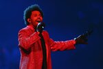 The Weeknd performs during the halftime show of the NFL Super Bowl 55 football game between the Kansas City Chiefs and Tampa Bay Buccaneers, Sunday, Feb. 7, 2021, in Tampa, Fla. (AP Photo/Chris Carlson)