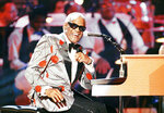 """FILE - Ray Charles, performs during the taping of """"Ray Charles: 50 Years in Music, uh-huh,"""" a benefit musical gala for Starlight/Starbright Foundation in Pasadena, Calif. on Sept. 20, 1991. Charles will be inducted into the Country Music Hall of Fame. (AP Photo/Kevork Djansezian, File)"""