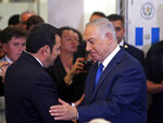 Israeli Prime Minister Benjamin Netanyahu, right, speaks to Guatemalan President Jimmy Morales ahead of the dedication ceremony of the embassy of Guatemala in Jerusalem, Wednesday, May 16, 2018. Guatemala has opened its new embassy in Jerusalem, becoming the second country to do so after the United States. (Ronen Zvulun/Pool Photo via AP)