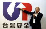 Han Kuo-yu of the Nationalist Party shows his campaign logo with a slogan