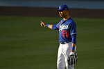 Los Angeles Dodgers' Mookie Betts stands in right field during baseball training Monday, July 6, 2020, in Los Angeles. (AP Photo/Mark J. Terrill)