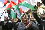 FILE - This Friday, Jan. 31, 2020 file photo, Palestinians chant slogans as they hold Palestinian flags, during a protest against the White House plan for ending the Israeli-Palestinian conflict, at Burj al-Barajneh refugee camp, south of Beirut, Lebanon. The financial crisis that the U.N. agency for Palestinian refugees is experiencing could lead to ceasing some of its activities in what would raise risks of instability in this volatile region, the head of the agency said Wednesday, Sept. 16. (AP Photo/Bilal Hussein, File)