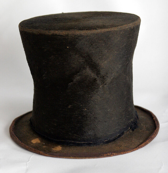 FILE - In this June 14, 2007 file photo, Abraham Lincoln's iconic stovepipe hat of questioned authenticity is photographed at the Abraham Lincoln Presidential Library and Museum in Springfield, Ill. A 16-month state study was unable to corroborate claims that a beaver-skin stovetop hat, a centerpiece of Illinois' Lincoln museum, once belonged to the 16th U.S. president, a Chicago-based public radio station reported Tuesday Dec. 24, 2019. Among the findings in the 54-page study was that the hat, once appraised at $6.5 million that, didn't appear to be Lincoln's size and that descendants of the original collectors weren't aware of the claim that Lincoln had owned the hat, WBEZ reported. (AP Photo/Seth Perlman File)
