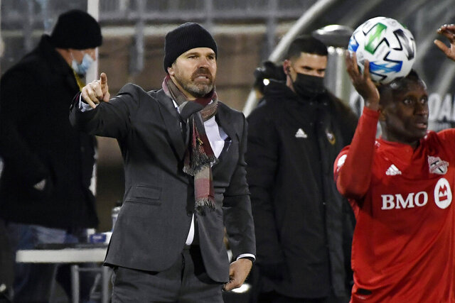 FILE - In this Nov. 24, 2020, file photo, then-Toronto FC head coach Greg Vanney, left, calls out to his team during the first half of an MLS soccer playoff match against Nashville SC in East Hartford, Conn., in this Tuesday, Nov. 24, 2020, file photo. The LA Galaxy have hired MLS Cup winner Greg Vanney as their new head coach. The club announced the deal Tuesday, Jan. 5, 2021, with Vanney, who played seven seasons with the Galaxy in two stints before his successful coaching career. (AP Photo/Jessica Hill)