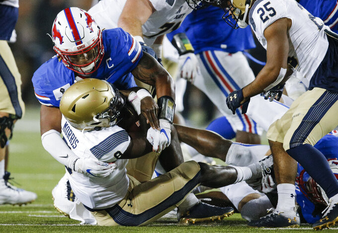 SMU linebacker Delano Robinson (3) sacks Navy quarterback Dalen Morris (8) during the second half of an NCAA college football game, Saturday, Oct. 31, 2020, in Dallas. (AP Photo/Brandon Wade)