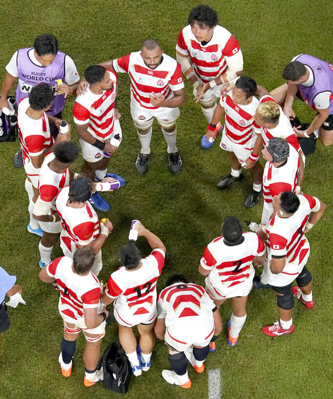 Japan's Michael Leitch talks to his players during the Rugby World Cup Pool A game at City of Toyota Stadium between Japan and Samoa in Tokyo City, Japan, Saturday, Oct. 5, 2019. (Kyodo News via AP)