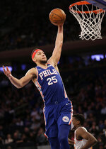 Philadelphia 76ers' Ben Simmons jumps to the basket during the first half of an NBA basketball game against the New York Knicks, Sunday, Jan. 13, 2019, in New York. (AP Photo/Seth Wenig)