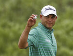 FILE - In this June 17, 2017, file photo, Bill Haas gestures after a birdie on the first hole during the third round of the U.S. Open golf tournament at Erin Hills in Erin, Wis. Haas has been released from hospital after being a passenger in a car crash which left one person dead and two injured, police in Los Angeles have said. The crash involved a Ferrari and a BMW in the Pacific Palisades neighbourhood at 6.31pm on Tuesday evening , Feb. 13, 2018, according to the Los Angeles Police Department. A car that the LAPD said belonged to the actor Luke Wilson was hit by the Ferrari just before the crash. (AP Photo/Chris Carlson, File)