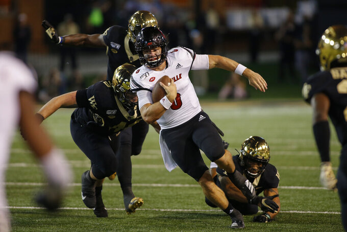 Louisville quarterback Evan Conley carries the football against Wake Forest in the second half of an NCAA college football game in Winston-Salem, N.C., Saturday, Oct. 12, 2019. Louisville won 62-59. (AP Photo/Nell Redmond)