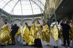 Models wait before the presentation of Chanel Haute Couture Spring/Summer 2020 fashion collection, Tuesday Jan.21, 2020 in Paris. (AP Photo/Thibault Camus)