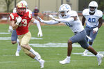 VMI wide receiver Chance Knox (left) is run down by The Citadel's Parrish Gordon during the first half of an NCAA college football game Saturday, April 17, 2021, in Lexington, Va. (David Hungate/Roanoke Times via AP)