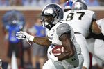 Vanderbilt running back Ke'Shawn Vaughn (5) runs upfield for a first down against Mississippi during the first half of their NCAA college football game in Oxford, Miss., Saturday, Oct. 5, 2019. (AP Photo/Rogelio V. Solis)