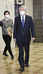 South Korean ambassador to Japan Nam Gwan-pyo, right, leaves Japan's Foreign Ministry in Tokyo Friday, Jan. 8, 2021. A South Korean court on Friday ordered Japan to financially compensate South Korean women forced to work as sex slaves for Japanese troops during World War II, the first such ruling expected to rekindle animosities between the Asian neighbors. Japan's Foreign Ministry said in a statement Friday that its vice Foreign Minister Takeo Akiba summoned Nam to register its protest against the ruling. (Yuki Sato/Kyodo News via AP)