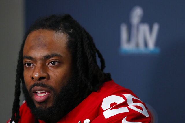 FILE - In this Jan. 30, 2020 file photo San Francisco 49ers cornerback Richard Sherman speaks during a media availability in Miami, for the NFL Super Bowl 54 football game against the Kansas City Chiefs. Sherman is calling on the NFL to go beyond commissioner Roger Goodell's statement condemning racism. Sherman said, Wednesday, June 10, 2020, the league needs to do a better job hiring minorities in coaching and front office positions and also be vigilant about calling out racism whenever it arises. (AP Photo/Wilfredo Lee, file)