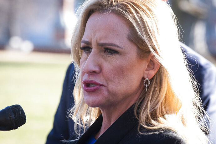 FILE - In this Jan. 22, 2020, file photo, Arkansas Attorney General Leslie Rutledge speaks to reporters at a news conference in Washington. A federal judge on Thursday, May 7, 2020, rejected a request by Arkansas' only surgical abortion clinic to block a rule requiring a negative coronavirus test before a woman undergoes the procedure.