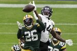 Green Bay Packers' Darnell Savage breaks up a pass intended for Jacksonville Jaguars' Terry Godwin during the second half of an NFL football game Sunday, Nov. 15, 2020, in Green Bay, Wis. (AP Photo/Morry Gash)