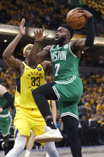 Boston Celtics guard Jaylen Brown (7) goes to the basket past Indiana Pacers center Myles Turner (33) during the second half of Game 3 of an NBA basketball first-round playoff series Friday, April 19, 2019, in Indianapolis. (AP Photo/Darron Cummings)