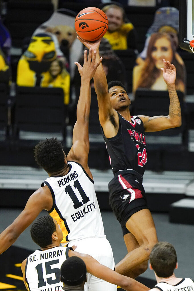 Northern Illinois guard Darius Beane shoots over Iowa guard Tony Perkins (11) during the second half of an NCAA college basketball game, Sunday, Dec. 13, 2020, in Iowa City, Iowa. Iowa won 106-54. (AP Photo/Charlie Neibergall)