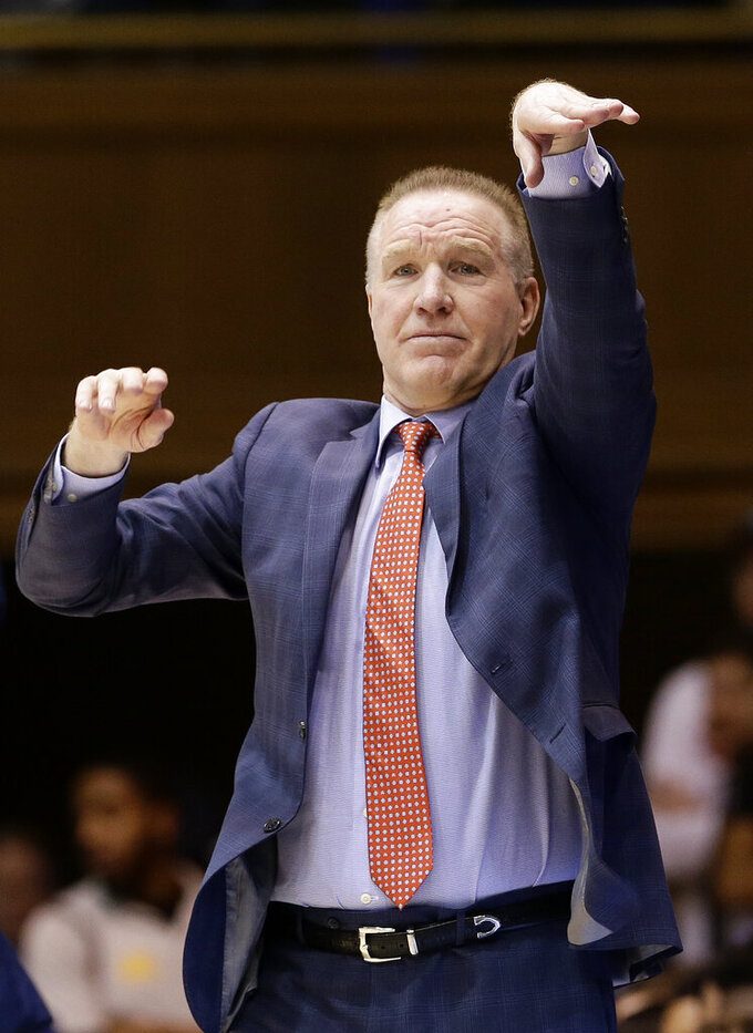 FILE - In this Feb. 2, 2019, file photo, St. John's head coach Chris Mullin directs his players during the first half of an NCAA college basketball game against Duke, in Durham, N.C. Mullin felt in his heart that it was time to move on from St. John's. Mullin stepped down as coach of the school he starred at as a player in the 1980s earlier this month after four years on the job.  (AP Photo/Gerry Broome, File)