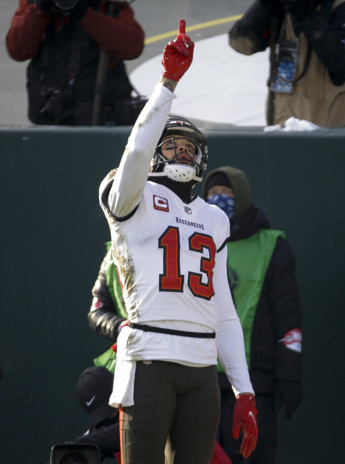 Tampa Bay Buccaneers' Mike Evans celebrates his touchdown reception agains the Green Pay Packers during the first half of the NFC championship NFL football game in Green Bay, Wis., Sunday, Jan. 24, 2021. (AP Photo/Mike Roemer)