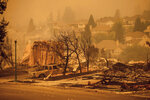 Homes leveled by the Glass Fire line a street in the Skyhawk neighborhood of Santa Rosa, Calif., on Monday, Sept. 28, 2020. (AP Photo/Noah Berger)